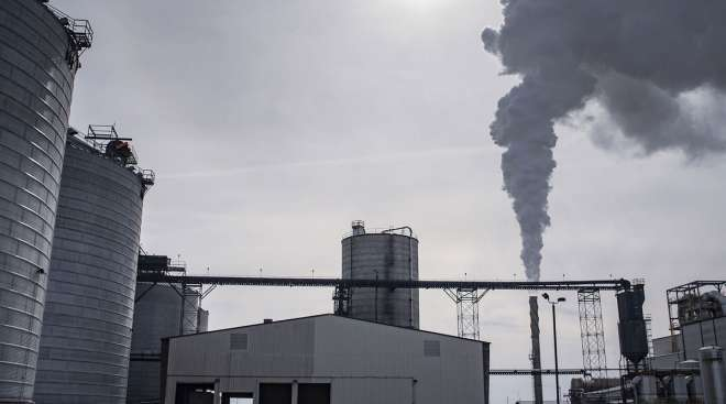 Steam billows out of a smokestack at a biorefining facility in Iowa. (Sergio Flores/Bloomberg News)