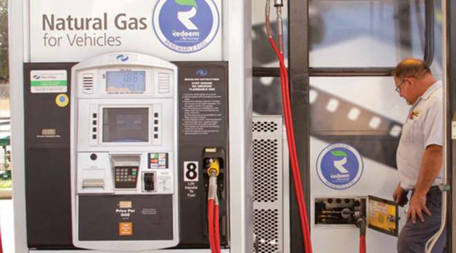 Technician pumps Redeem by Clean Energy Fuels