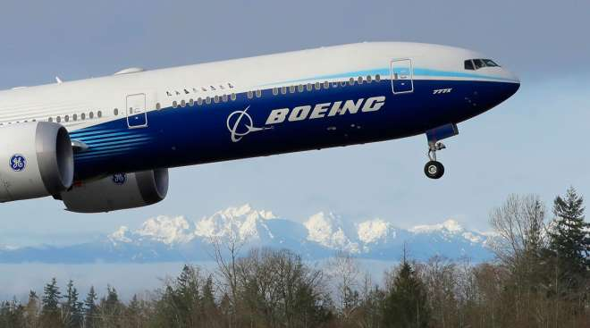 A Boeing 777X takes off on its first flight in Everett, Wash.