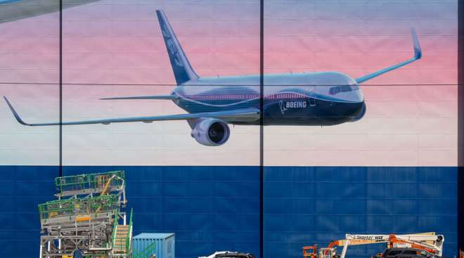 A plane image is seen on the outside of Boeing's facility in Everett, Wash.