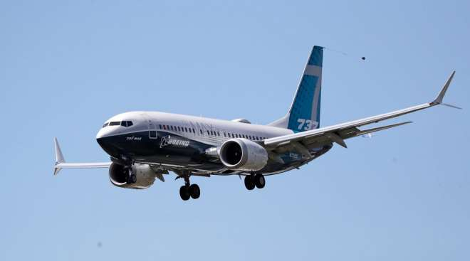 A Boeing 737 Max jet heads to a landing after a test flight in Seattle on June 29.