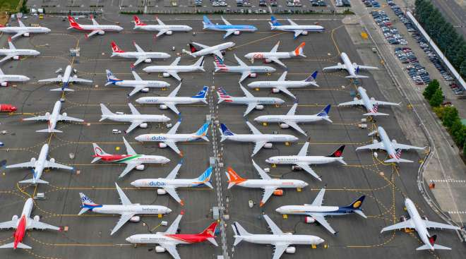 Boeing 737 Max planes are stored on employee parking lots in Seattle in June 2019.