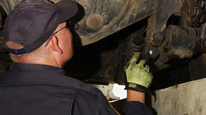 An inspector takes a look at truck brakes