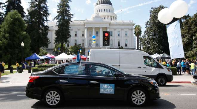 Dozens of AB 5 supporters rally at California's Capitol in Sacramento in August 2019. (Rich Pedroncelli/Associated Press)