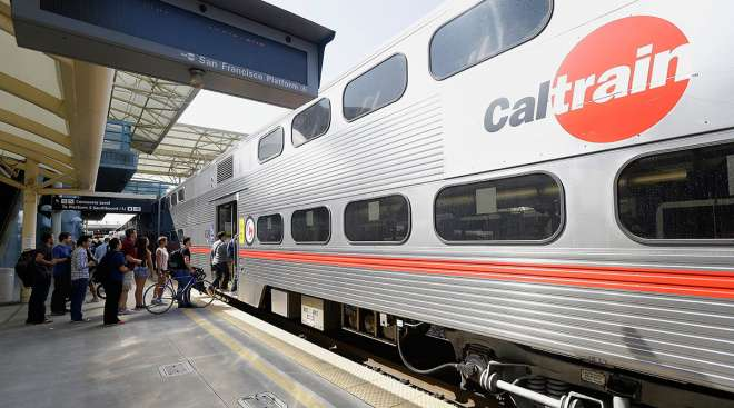 Commuters board a Caltrain car