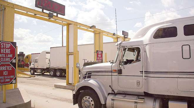 A truck enters Canada from the United States