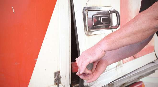 Thief trying to steal cargo out of trailer