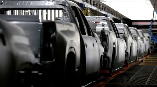Pickup truck frames sit on the assembly line at the GM plant in Flint, Mich.