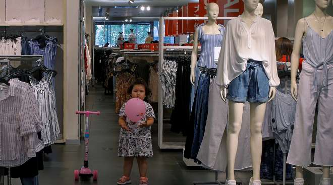 Child at store in China with balloon