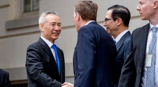 Group of American and Chinese officials greet each other