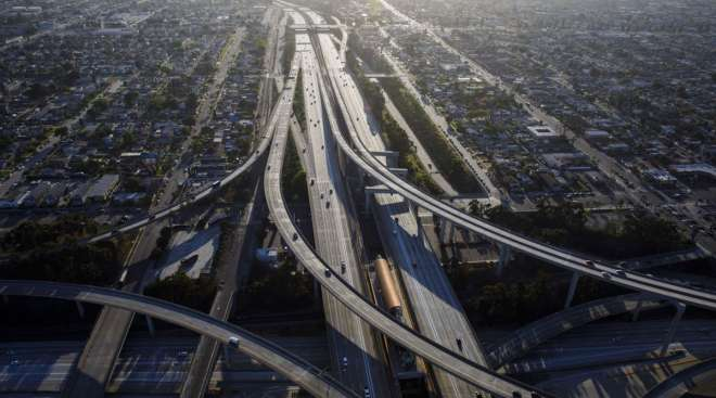 Vehicles drive in light traffic on freeways in Los Angeles, Calif. (Patrick T. Fallon/Bloomberg News)