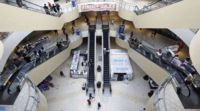 Shoppers walk through the Queens Center shopping mall in New York in September 2020.