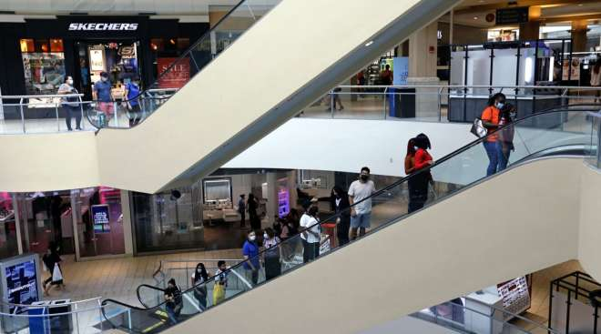 Shoppers are seen at the Queens Center shopping mall on Sept. 9.