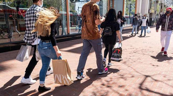 Shoppers carry bags on Market Street in San Francisco