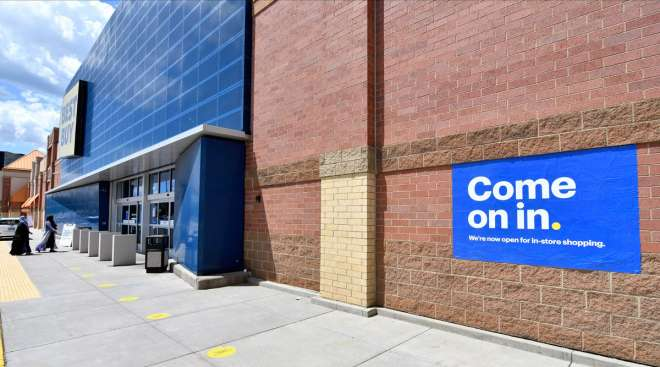 Shoppers, left, head to the entrance of a Best Buy store in Minnesota on June 24.