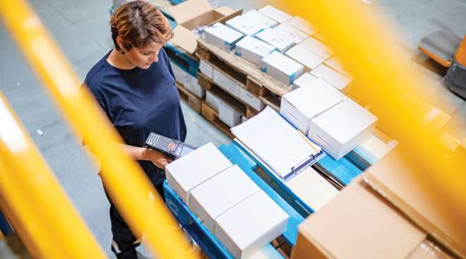 Worker at supply chain facility