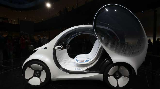 A door sits open on a Daimler Smart Vision EQ fortwo electric autonomous self-driving concept automobile.