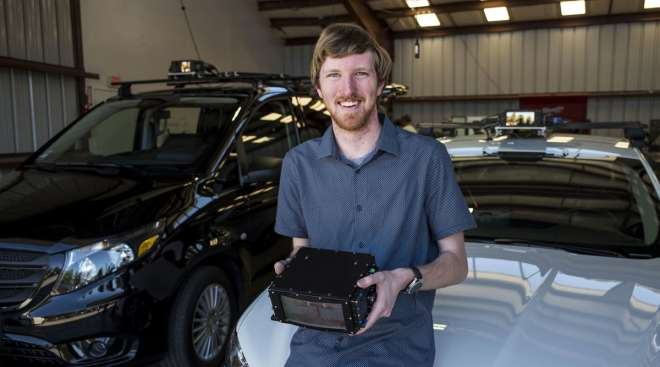 Austin Russell, founder and CEO of Luminar Technologies, holds a lidar box for a photograph.