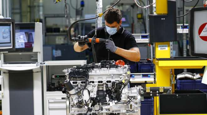 An employee assembles a Mercedes-Benz automobile in Germany on April 22.