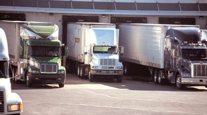 Truck drivers waiting at a loading dock