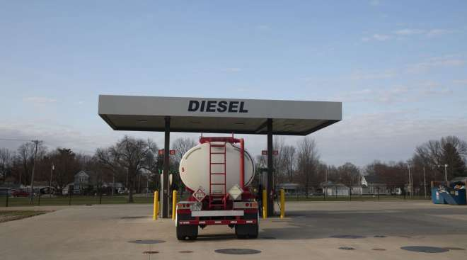 A tanker truck sits parked at a diesel fuel pump in Princeton, Ill., in April 2020.