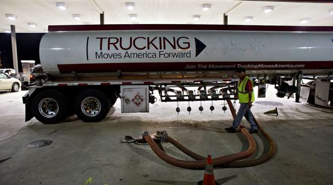 Diesel tanker with Trucking Moves America Forward banner