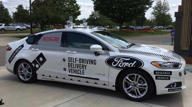 The specially designed delivery car that Ford Motor Co. and Domino's Pizza will use to test self-driving pizza deliveries, at Domino's headquarters in Ann Arbor, Mich. Ford and Domino's are teaming up to test how consumers react if a driverless car delive