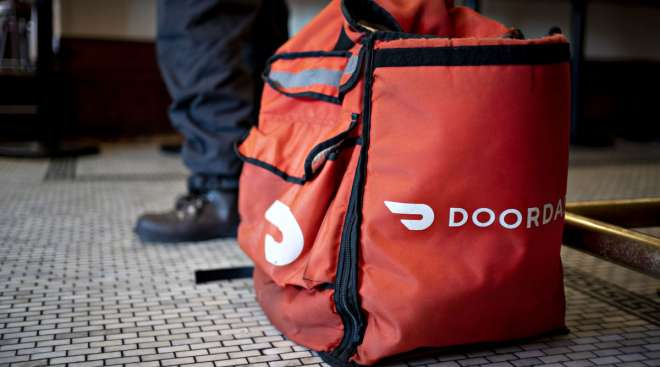 A DoorDash delivery bag sits on the floor inside a Washington, D.C., restaurant on March 26.