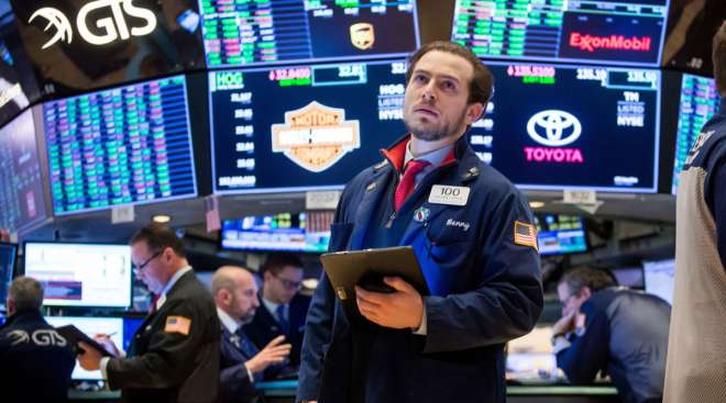 A trader reacts on the floor of the New York Stock Exchange on Feb. 26. For the last month, global stocks have cratered.