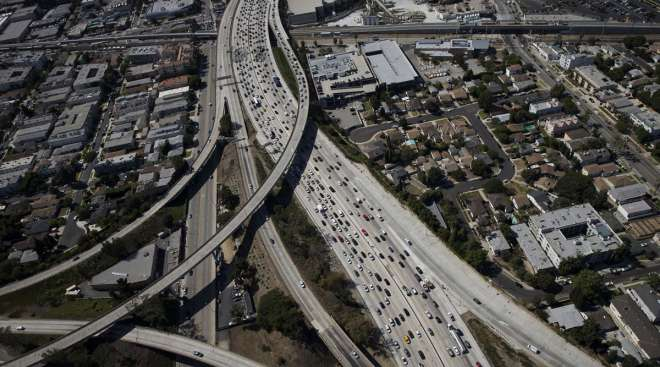 Vehicles sit in rush hour traffic at an interchange in Los Angeles.