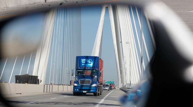 A truck as seen in a side-view mirror on the Mississippi River Bridge on I-70 in St. Louis, Missouri.