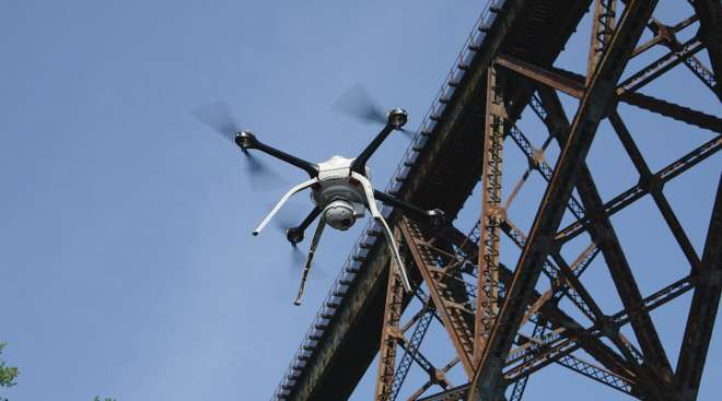 A drone inspects a bridge