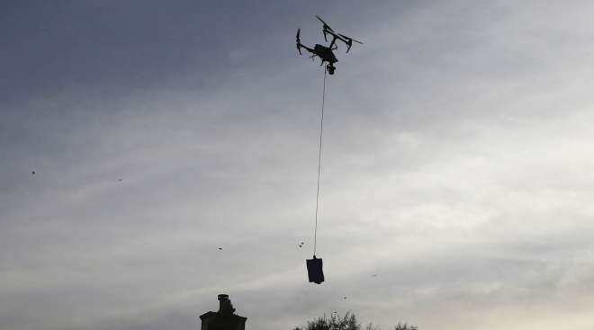 A drone descends to deliver a COVID-19 test kit to a home in El Paso, Texas. (Mario Tama/Getty Images via Bloomberg News)