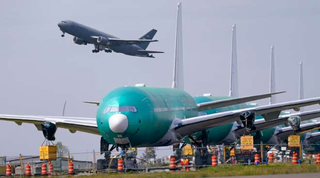 Boeing jets sit parked near Boeing's production facility in Everett, Wash. (Elaine Thompson/Associated Press)