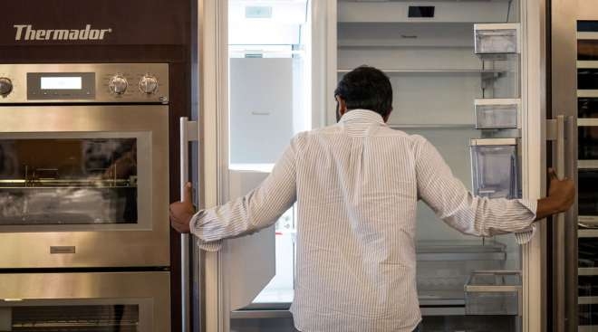 A customer views a refrigerator displayed for sale at an appliance story in San Jose, Calif.