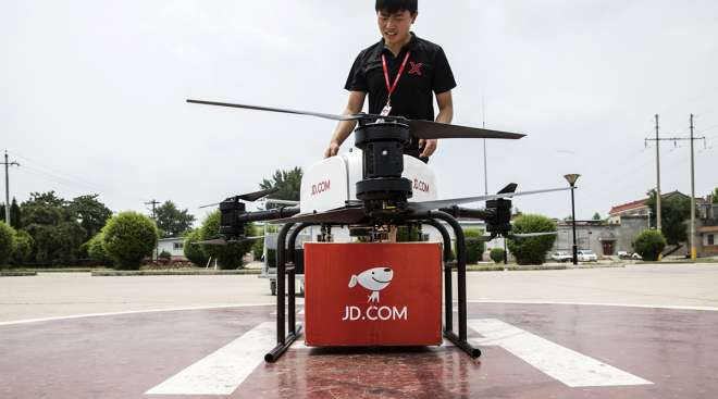 A JD.com Inc. drone during a package delivery demonstration at a launch pad in China. (Qilai Shen/Bloomberg News)