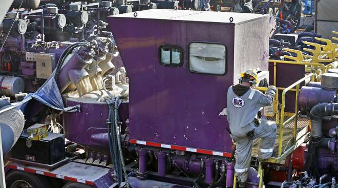 A machine that mixes sand and water before it is pumped underground during a hydraulic fracturing operation in Colorado