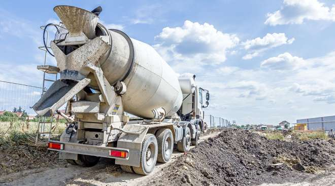 Concrete truck heads to unload its payload