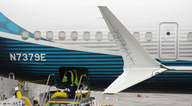 An employee works on a Boeing 737 Max 9 plane at the company's facility in Renton, Wash.