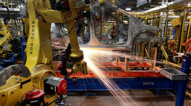 Robots weld a vehicle at the GM Orion Assembly plant in Michigan in May 2011.