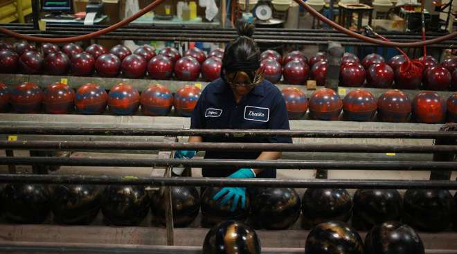 factory worker with bowling ball
