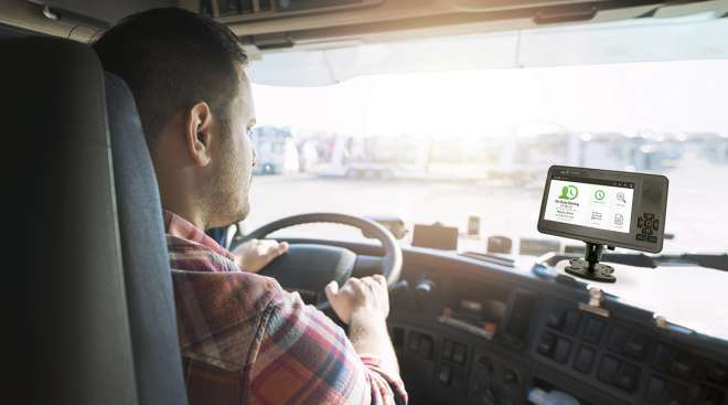 Driver looking at screen in truck