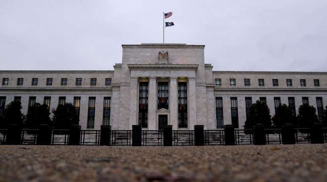 The Federal Reserve building is seen in Washington, D.C., on Dec. 1. (Stefani Reynolds/Bloomberg News)