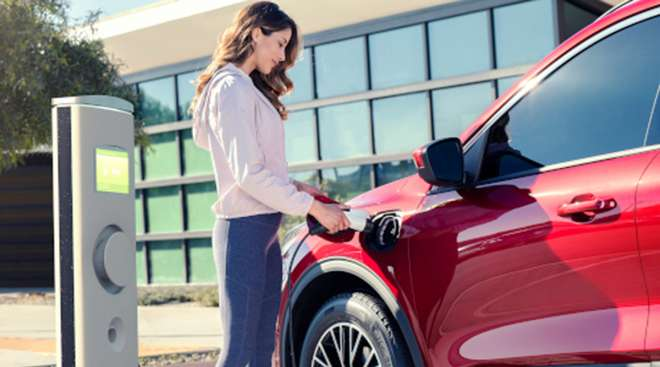 Woman fuels Ford hybrid