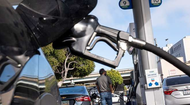 Customers refuel at a Chevron Corp. gas station in San Francisco