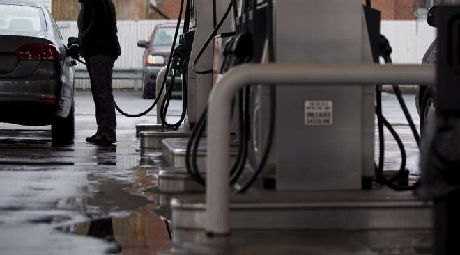 A customer refuels his vehicle at a Hess Corp. gas station in Washington, D.C.