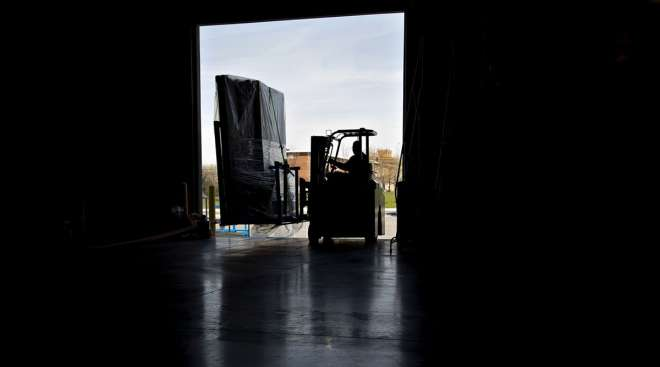 A worker uses a forklift to move packages at a facility in Baltimore.