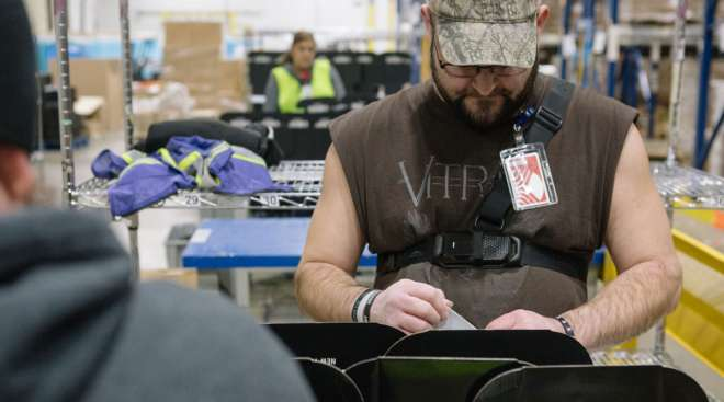 A worker prepares packages at a Geodis e-commerce fulfillment center in Pennsylvania. (Michelle Gustafson/Bloomberg News)