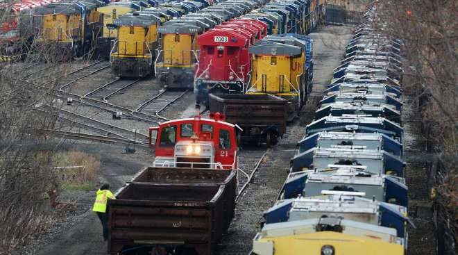A crew works near locomotives stored at the Wabtec Corp. location in Lawrence Park Township, Pa.
