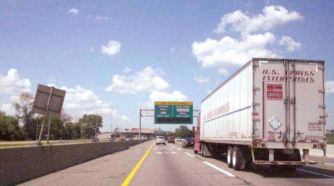 Vehicles travel up to an express toll on the New Jersey Turnpike